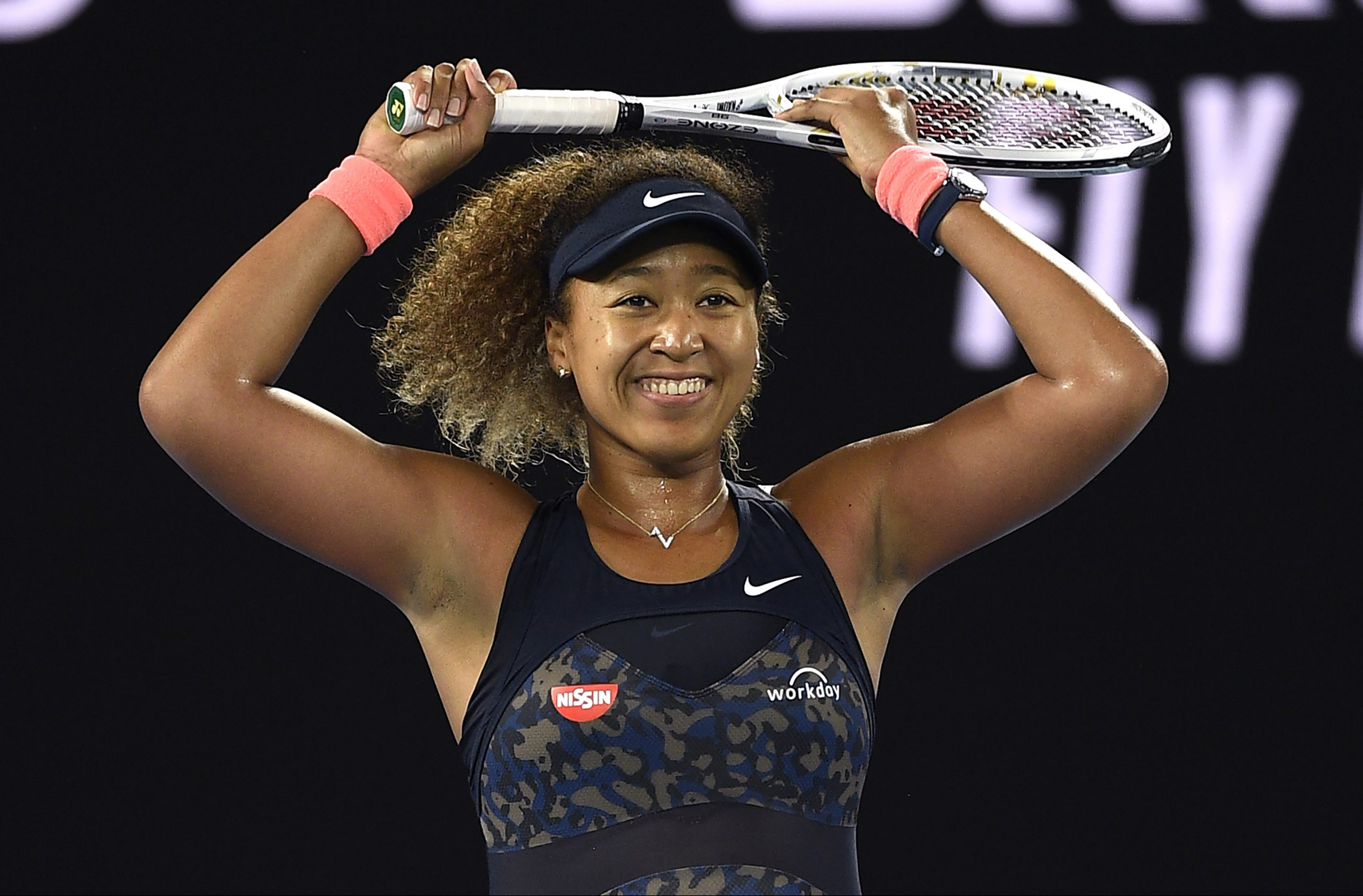 Japan's Naomi Osaka celebrates after defeating United States' Jennifer Brady during the women's singles final at the Australian Open tennis championship in Melbourne, Australia, Saturday, Feb. 20, 2021..(AP Photo/Andy Brownbill)
